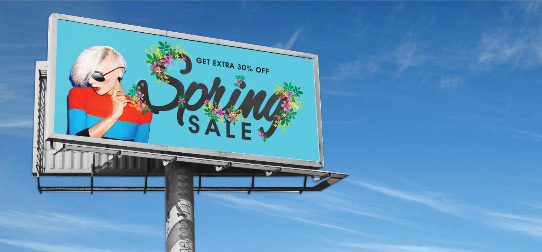 spring sales banner displayed on a billboard