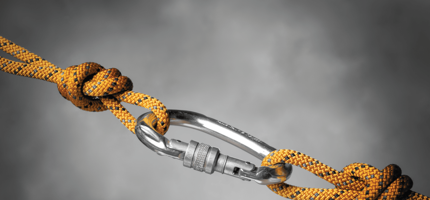 carabiner with ropes pulling from each side